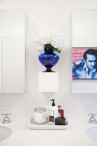 A street artist's colorful, graphic painting of British pop star Morrissey stimulates contemplation and quells bathroom boredom. Photo 7 of SOMO: southern mod modern home