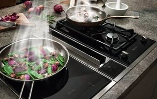 Kitchen News and Trends from Cologne - LivingKitchen 2017 - Photo 4 of 7 - Home appliance manufacturer NEFF is launching a new range of FlexInduction hobs with integrated ventilation, specially designed for those of us who like to have a clear view and lots of head space in the kitchen.<br><br>The new cooktop ventilation combines the functions of the FlexInduction hob with the efficiency of the venting hood in one single appliance thus giving you more flexibility, headspace and a free view of the kitchen.