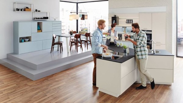 """Whether in a small city apartment or a spacioushouse - the shape of the """"Y-kitchen"""" makes thekitchen a central communication platform."""