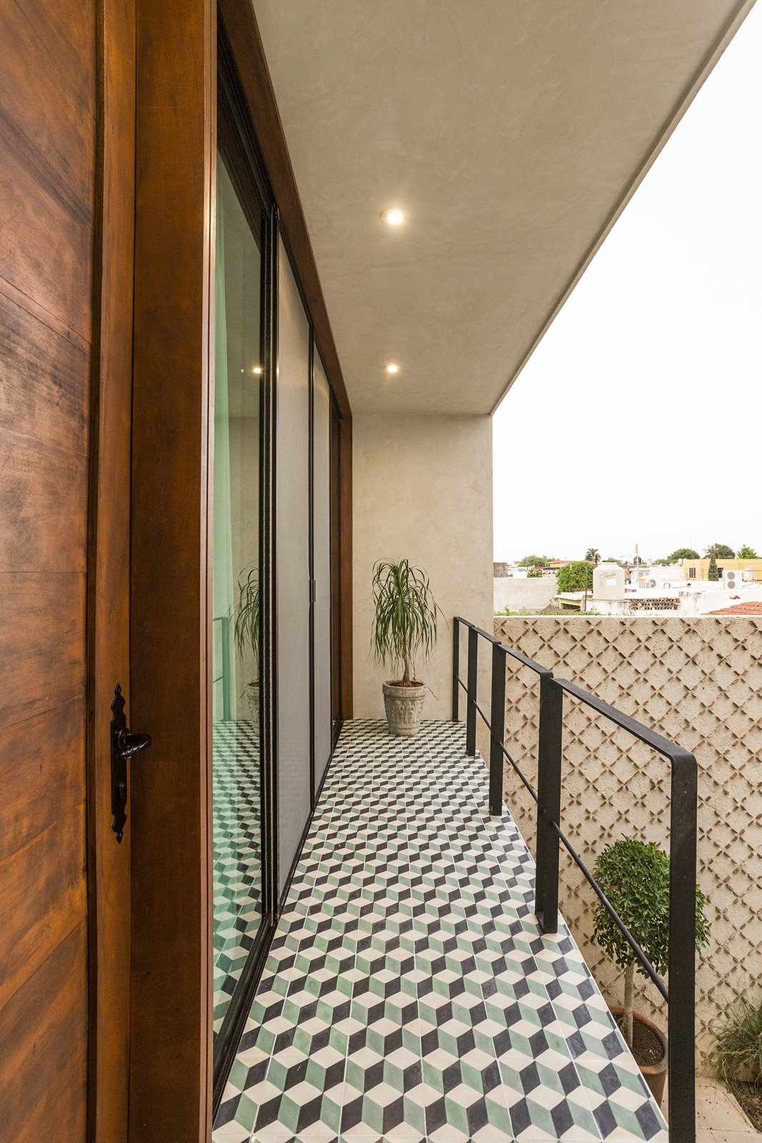 Tagged: Outdoor, Tile Patio, Porch, Deck, and Metal Fences, Wall.  Lemon Tree House by Taller Estilo Arquitectura S de R.L de C.V