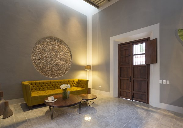 Modern home with living room, sofa, floor lighting, coffee tables, track lighting, and cement tile floor. Color is important in Mexico and furniture and Art provide this on the Lemon tree house Photo 12 of Lemon Tree House