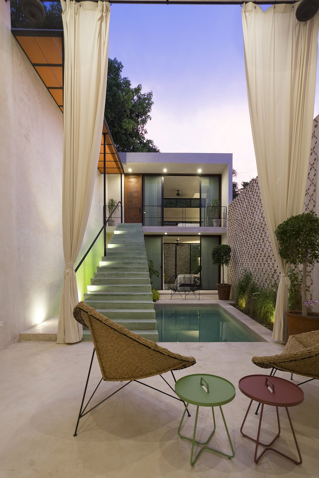 The patio is the prefect conector of the old and new architecture Tagged: Outdoor, Trees, Grass, Plunge Pools, Tubs, Shower, Small Patio, Porch, Deck, Concrete Patio, Porch, Deck, and Horizontal Fences, Wall.  Lemon Tree House by Taller Estilo Arquitectura S de R.L de C.V