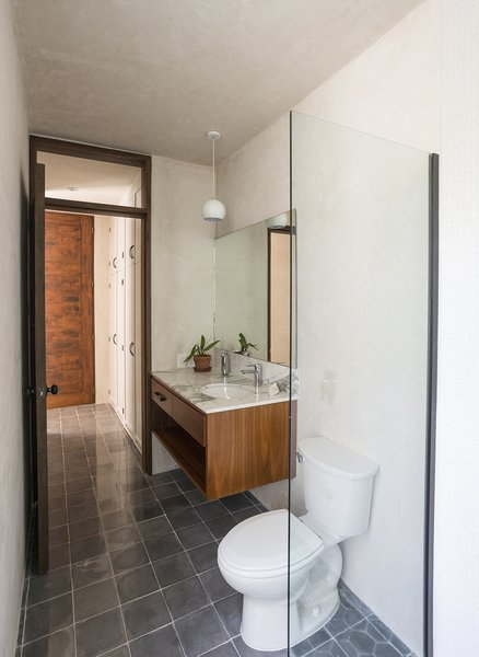 Modern home with bath room, marble counter, undermount sink, and cement tile floor. Downstairs bathroom Photo 16 of Lemon Tree House