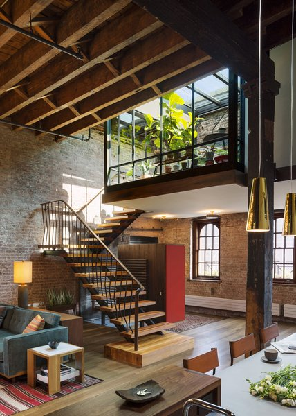 A custom steel stair repurposes timbers from the old roof joists as treads and landings. Photo 7 of Tribeca Loft modern home