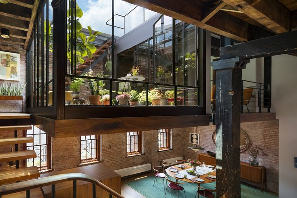 The court exposes the sky, fills the previously dark loft with natural daylight, and brings accessible outdoor space into the primary living zones. Photo 2 of Tribeca Loft modern home