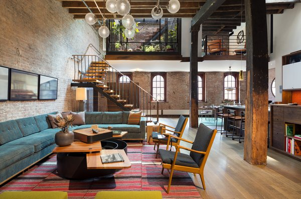 The residence is transformed by a relocated mezzanine featuring a sunken court which connects to the planted green roof garden above. Photo  of Tribeca Loft modern home