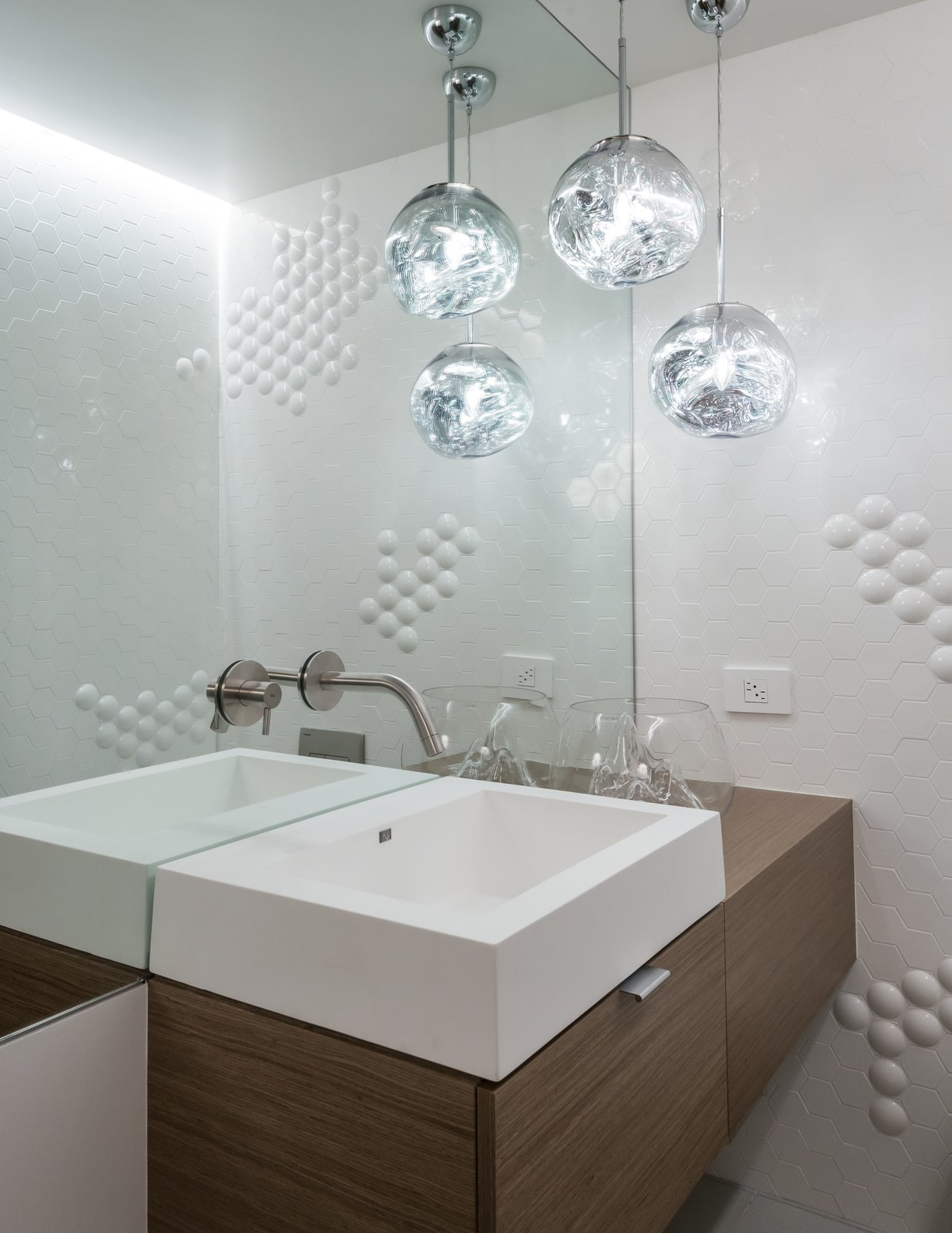 "Powder Room features Tom Dixon ""Mini Melt' pendants.  Montgomery Station (BART) wall tile pays homage to the Owner's San Francisco roots. San Francisco Meets Jackson Hole in a Modern Renovation by Carney Logan Burke Architects"