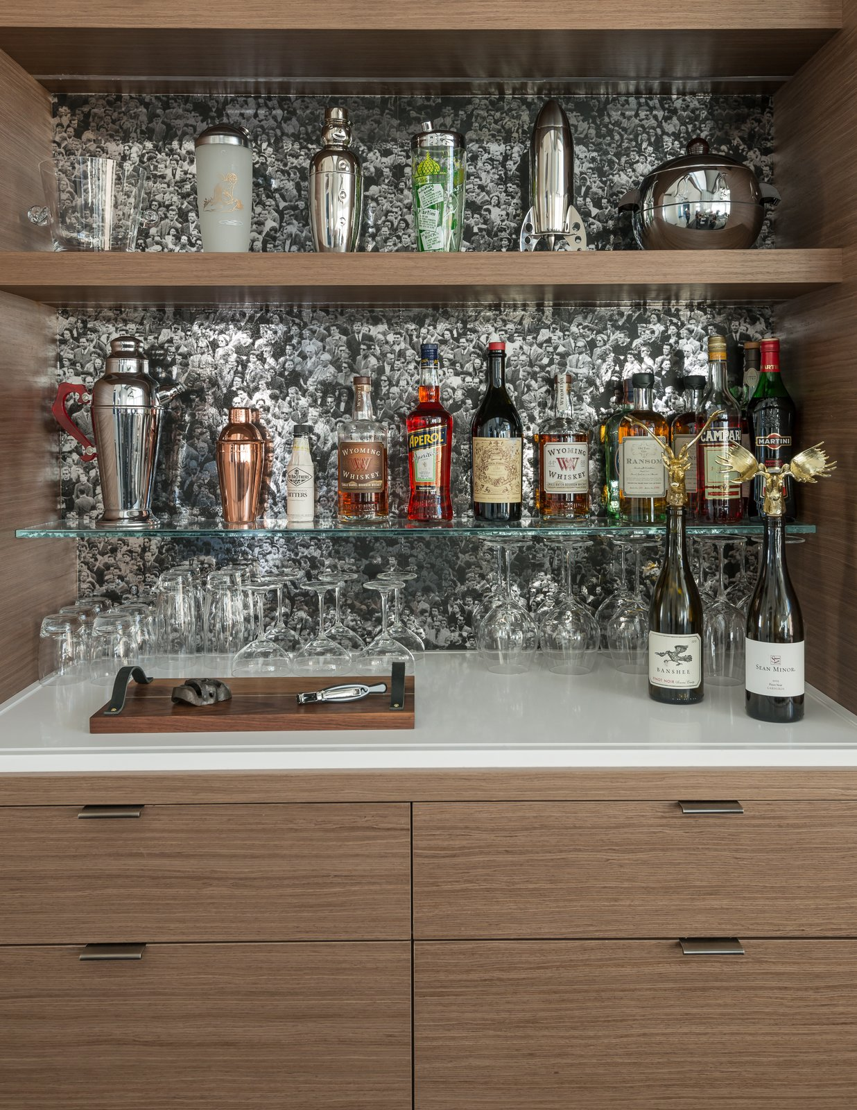 "Living Room Bar wallpaper:  Flavor Paper, 'Where's Andy,"" in chrome mylar.  San Francisco Meets Jackson Hole in a Modern Renovation by Carney Logan Burke Architects"