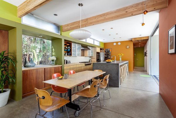 Modern home with concrete counter, dining room, table, bar, stools, accent lighting, chair, storage, pendant lighting, recessed lighting, and concrete floor. Dining Room to Kitchen Photo 3 of Land Park Residence