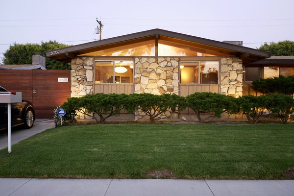 The house was built in 1954. However, this front is an extension that was done in 1962 to expand the dining space and the kitchen. Photo  of Kallin Rancho modern home