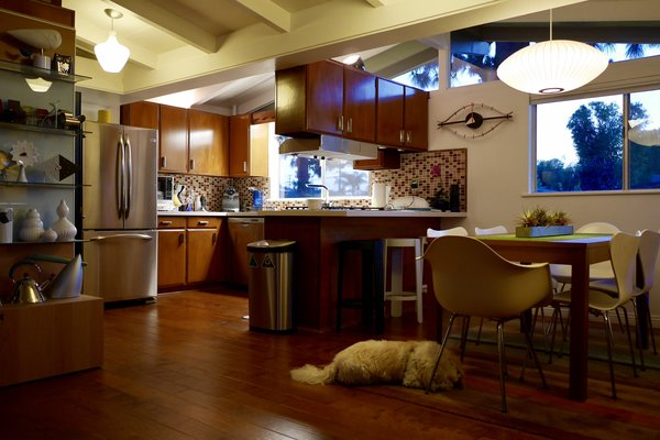The kitchen cabinets were original to the 1962 remodel. The countertops, the backsplash and appliances were the only recent updates. Photo 6 of Kallin Rancho modern home
