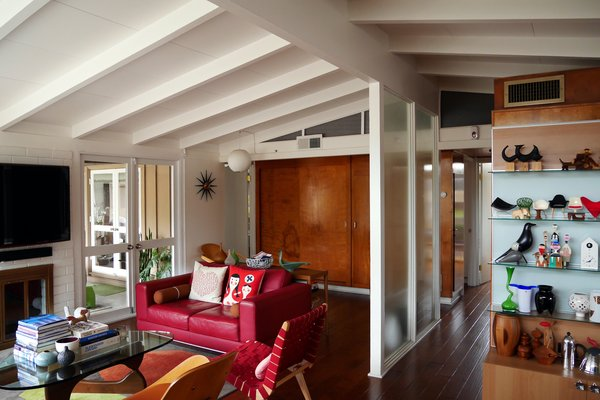 Modern home with living room. The living room and hallway cabinets are original birch panelled pieces. Photo 7 of Kallin Rancho
