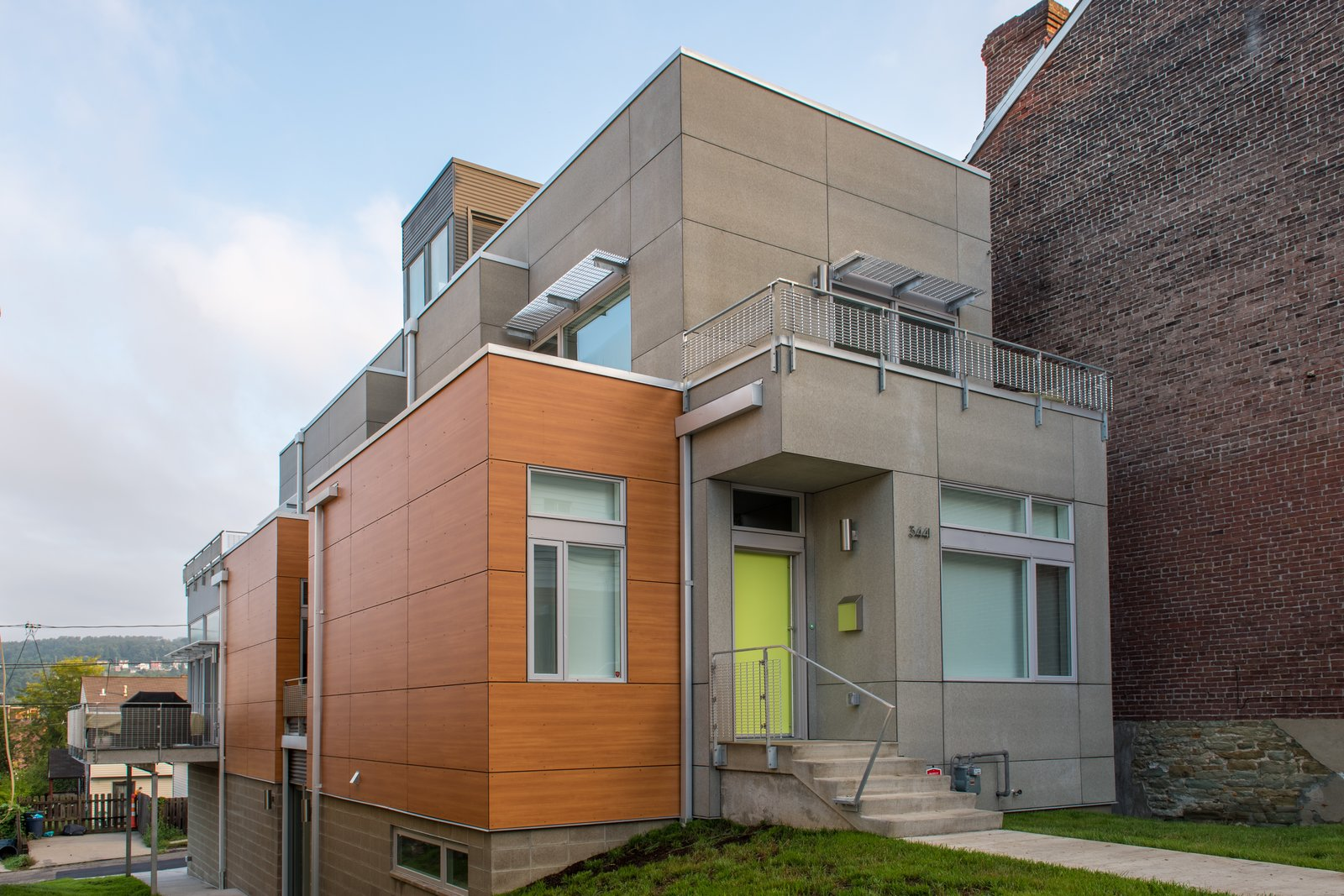 The massing of the Ligonier Street Residence largely consists of a narrow, articulated rectangular volume that is bisected by a custom central staircase that links all four levels of the 3,557 square foot home. The natural sloping topography of the site allows for access to the home at the lower basement level from an alley condition at the downhill property edge and at the first floor from the public street at the uphill property edge.