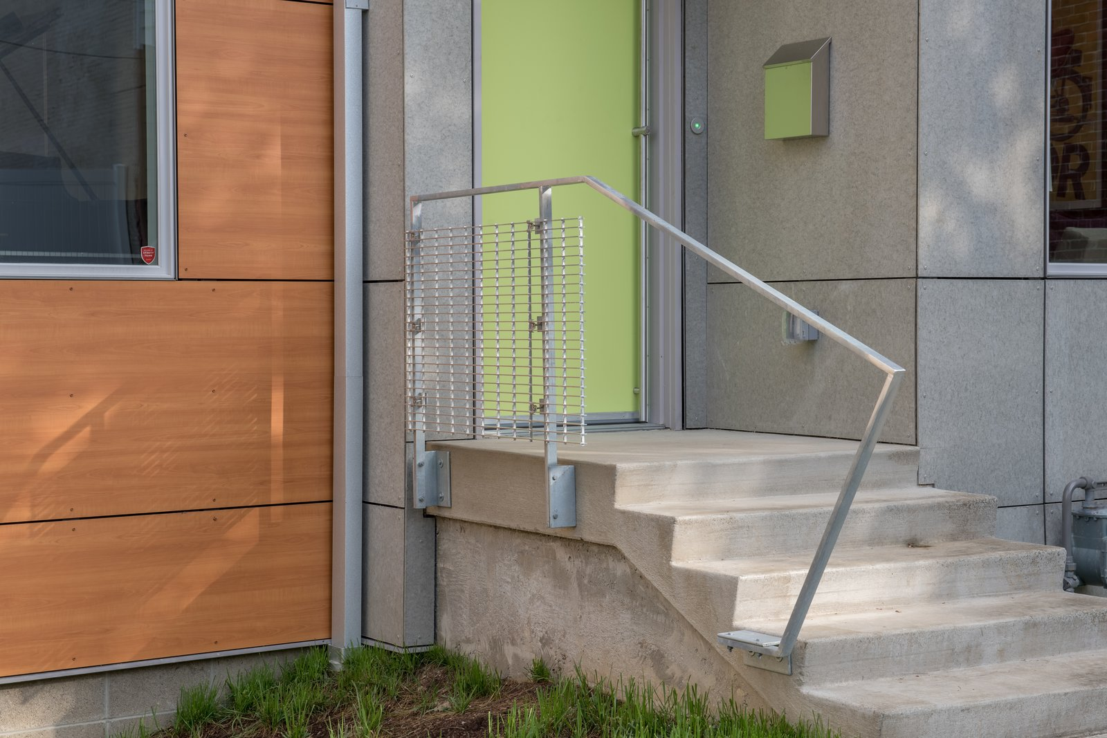 Exterior decks and railings also utilize galvanized steel support members and aluminum bar grating to provide a slightly industrial, yet refined appearance.  Ligonier Street Residence by mossArchitects