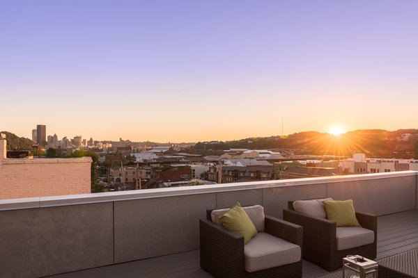 A large roof deck is located at the northwest portion of the third floor, with expansive views of downtown Pittsburgh. Photo 6 of Ligonier Street Residence modern home