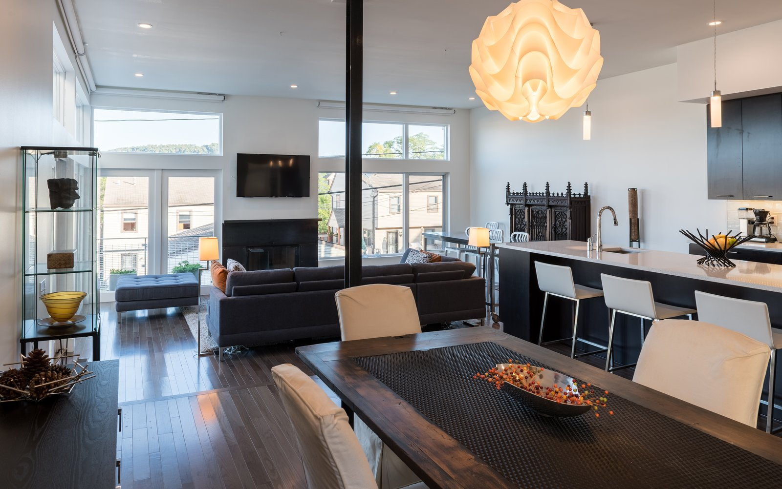 A large, open plan great room containing the kitchen, dining, and family room functions are located at the northwest portion of the floor plan, allowing for views of downtown Pittsburgh.