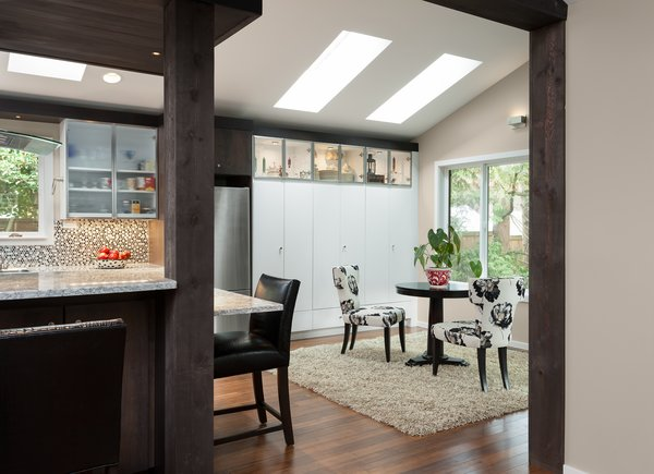 We call it the morning room now.  Skylights, improved windows and lighting contribute to a comfortable place to be.  Opening up walls ties this room to kitchen and living spaces making a wonderful place for entertaining.   Photo 3 of The Ping Pong Home modern home