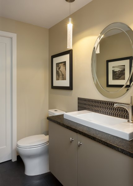 Remodeled powder room is clean, modern and compact.   Photo 10 of The Ping Pong Home modern home