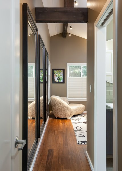 This view to the master bedroom shows the inclusion of the same beam details used elsewhere in the home. Photo 8 of The Ping Pong Home modern home