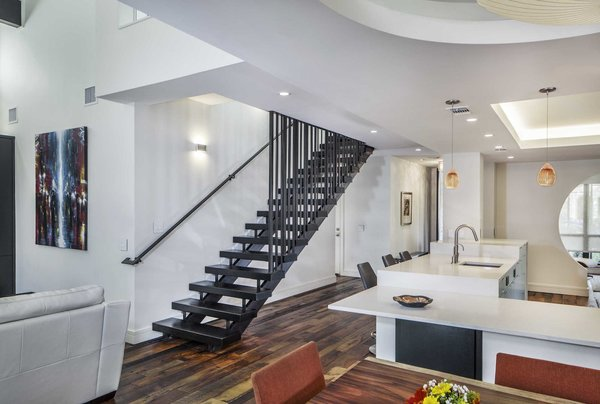 The stair design came from homeowner Robert Mockley, who wanted something he had never seen before. He suggested different size bars spaced at different uneven  locations to give the railing a unique look.  Photo 8 of Collier Residence modern home
