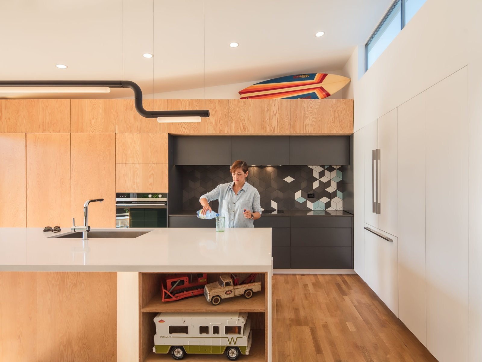 Grohe kitchen Faucet + Tonka Winnebago toy was inspo for exterior wood siding  The Beach Lab by Surfside Projects