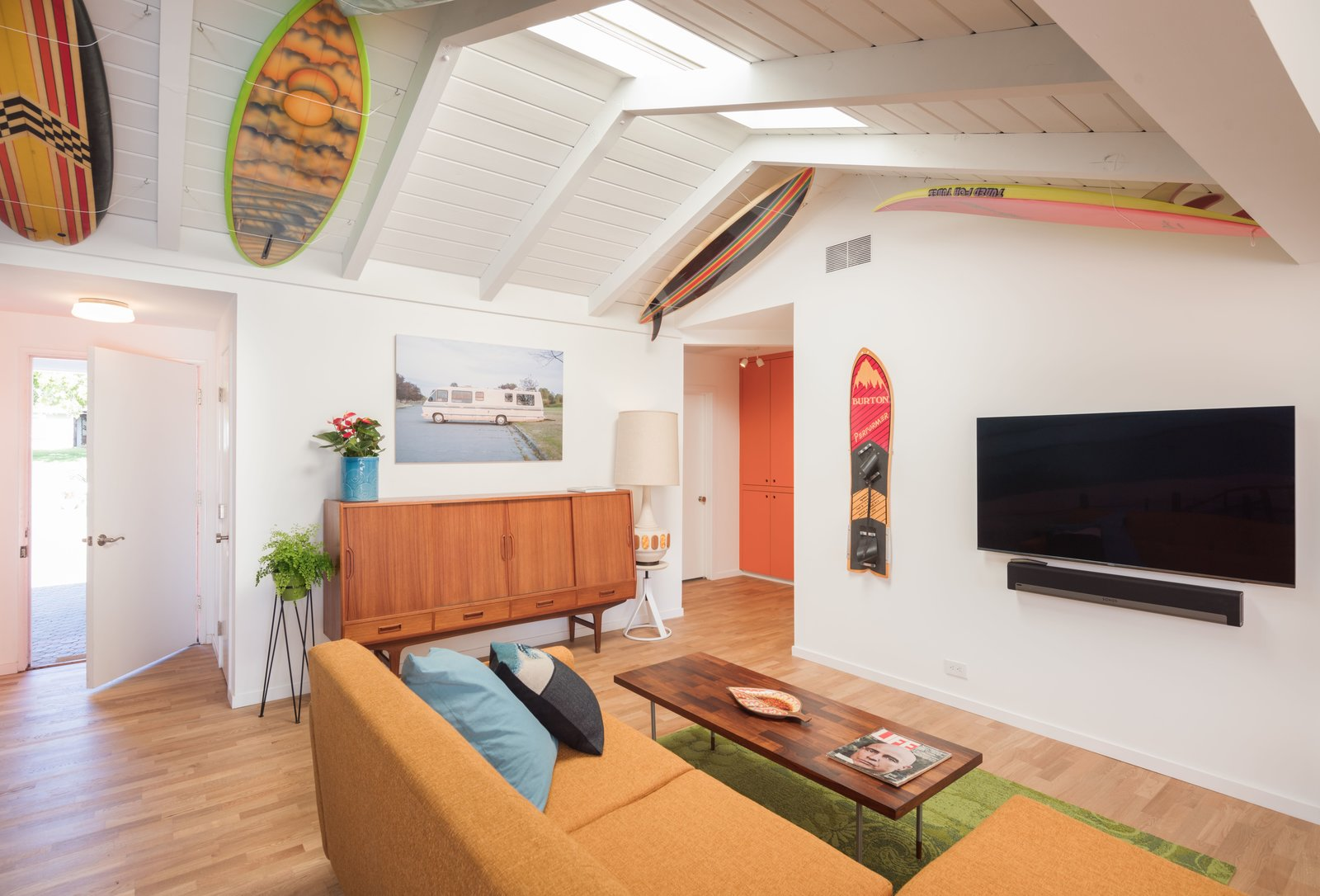 Exposed wood beams of the original home from 1957 + Vintage Burton Performer snowboard c. '84  The Beach Lab by Surfside Projects