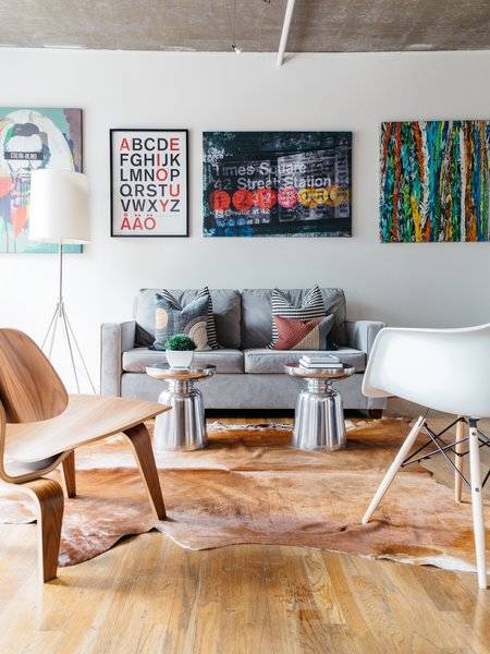 Chairs by Charles & Ray Eames for Herman Miller provide touches of mid-century modern to the living area.  Photo  of Witt Place Loft modern home