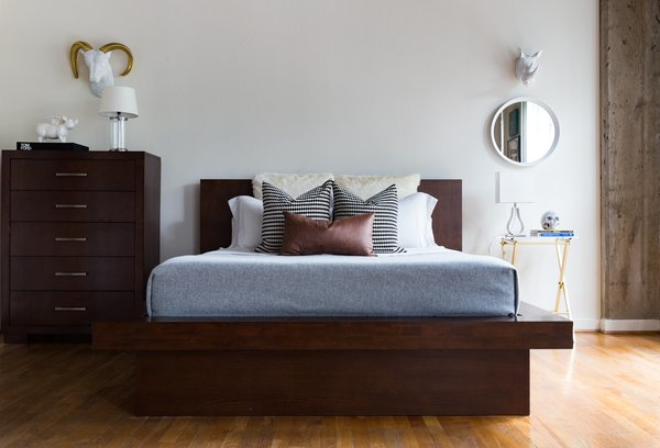 Various textures, dark brown furniture, and metallics, add a warm and calm vibe to the bedroom.  Photo 2 of Witt Place Loft modern home