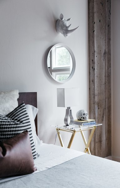 The Novo Acrylic Folding Table by Robert & Cortney Novogratz for CB2 was used as a nightstand and partnered with a metallic skull from Z Gallerie. Photo 3 of Witt Place Loft modern home