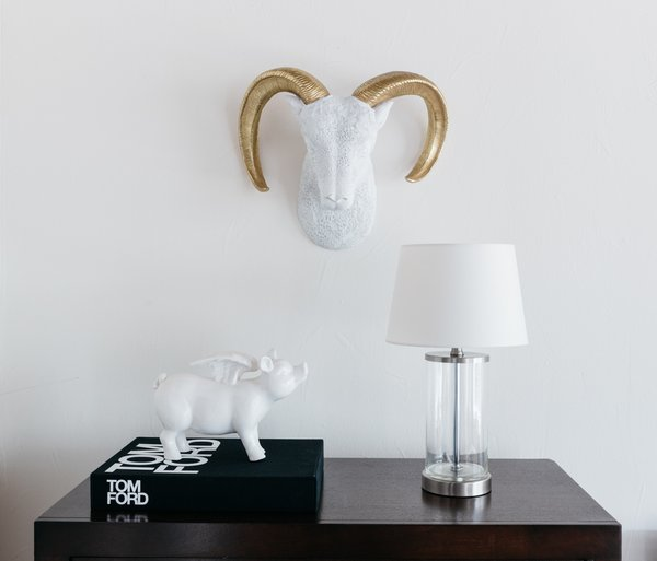 The Tom Ford book adds sophistication to the dresser top, along with the ceramic flying pig and glass fillable lamp. Photo 4 of Witt Place Loft modern home
