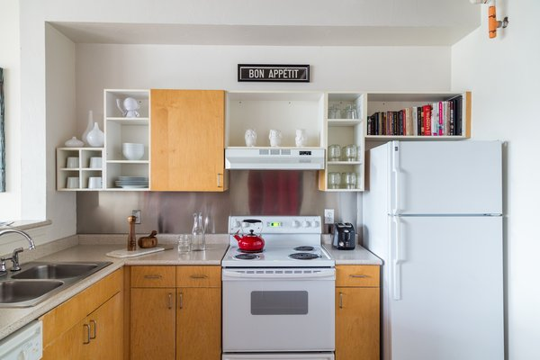 The open shelving in the kitchen was used to display books, decor items, and dinnerware. Photo 6 of Witt Place Loft modern home