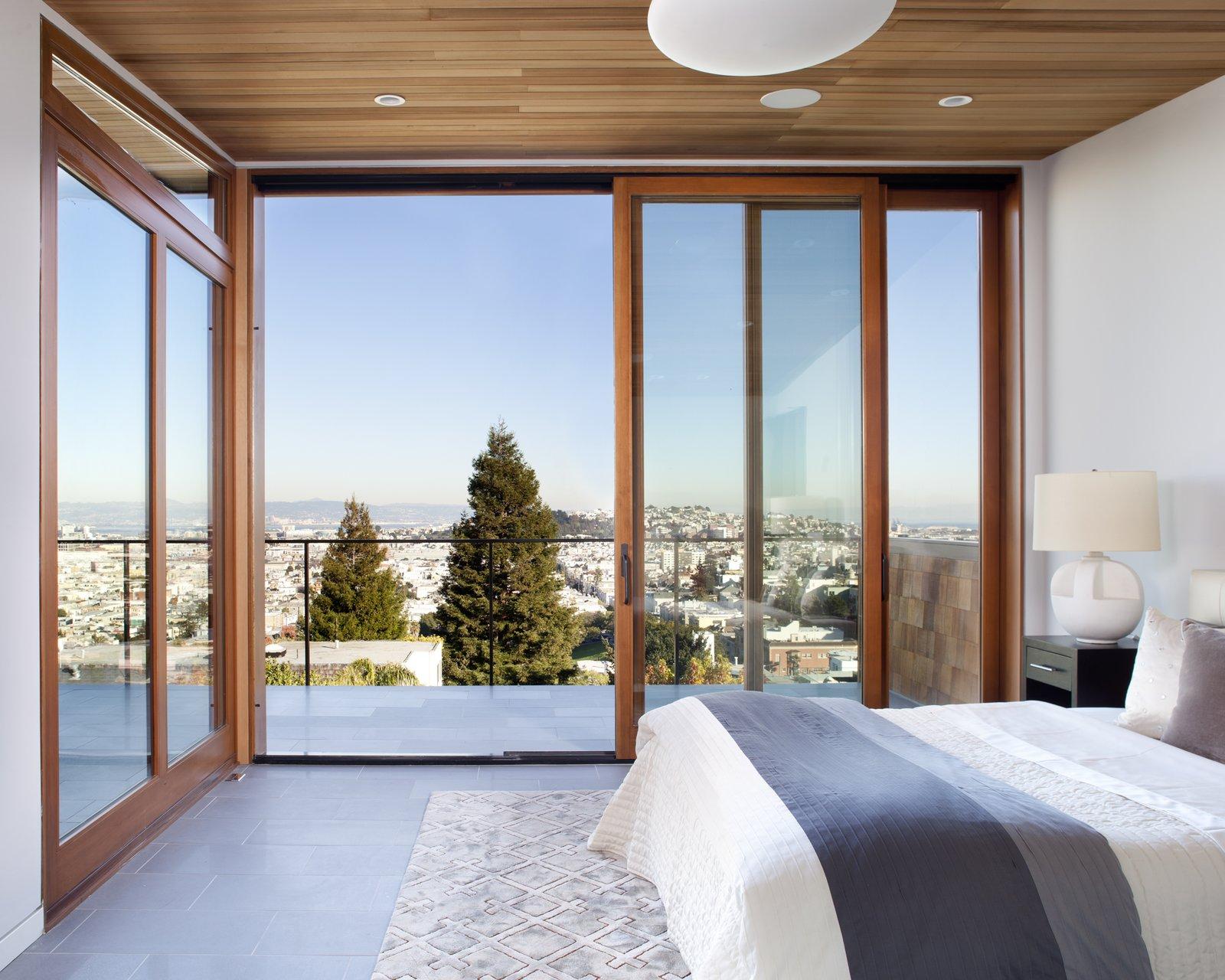 cedar wood ceiling quantum sliding doors porcelain tile flooring master bedroom