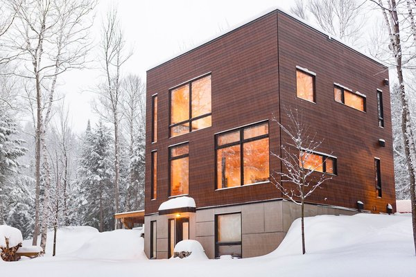 If you have any ideas please share.   I have designed and built this house. The house has concrete floors to absorb solar energy from the south-facing windows. I would like to add some shade on these windows. In mid season, too much sun gets in the house.  Thanks! Photo 6 of Cubic house in the Laurentian forest modern home