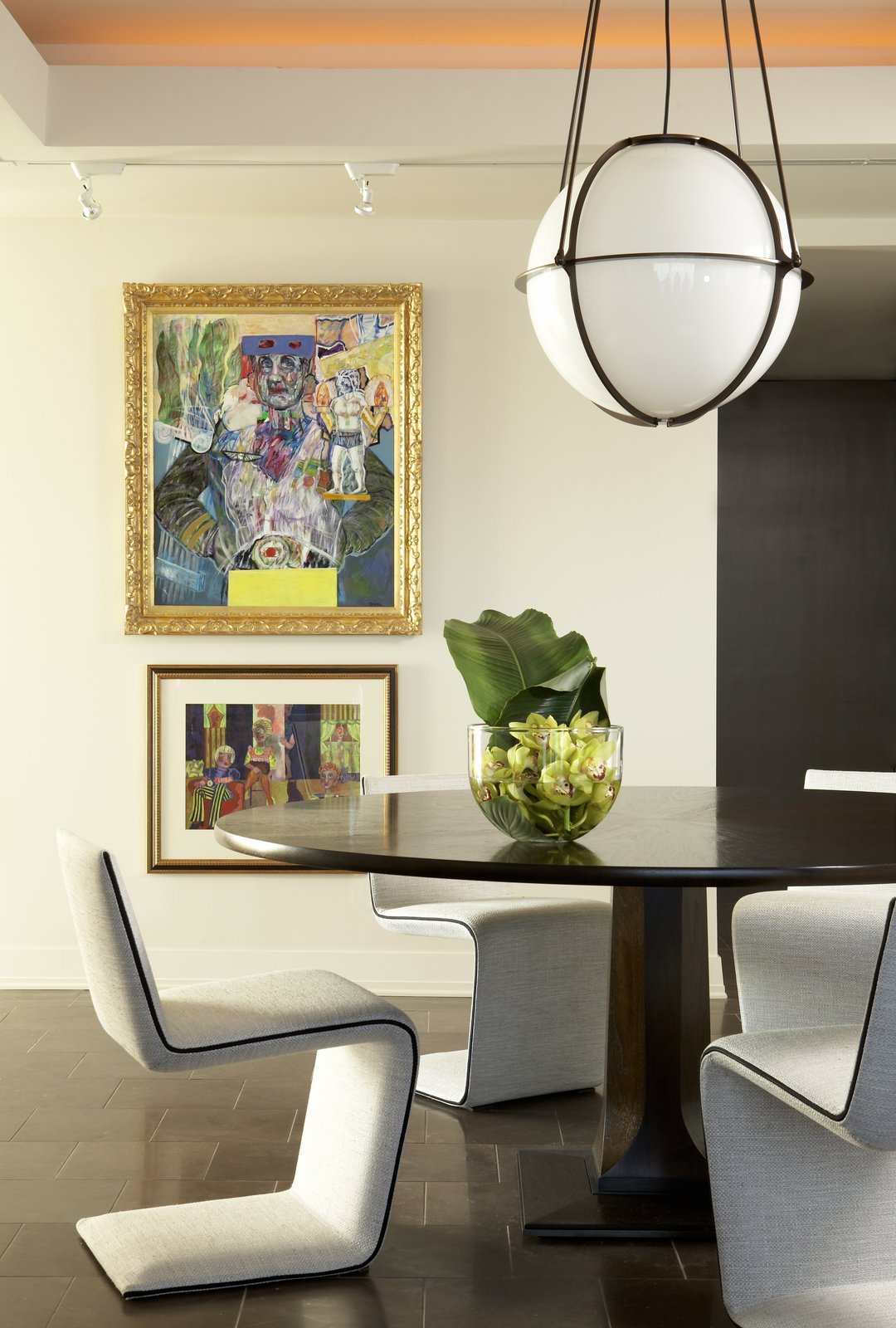Mark Williams designed this Plaza Towers dining space with lots of light and art. The Globe Pendant is by Boyd Lighting.  Delicious Dining Room Lighting by Boyd Lighting