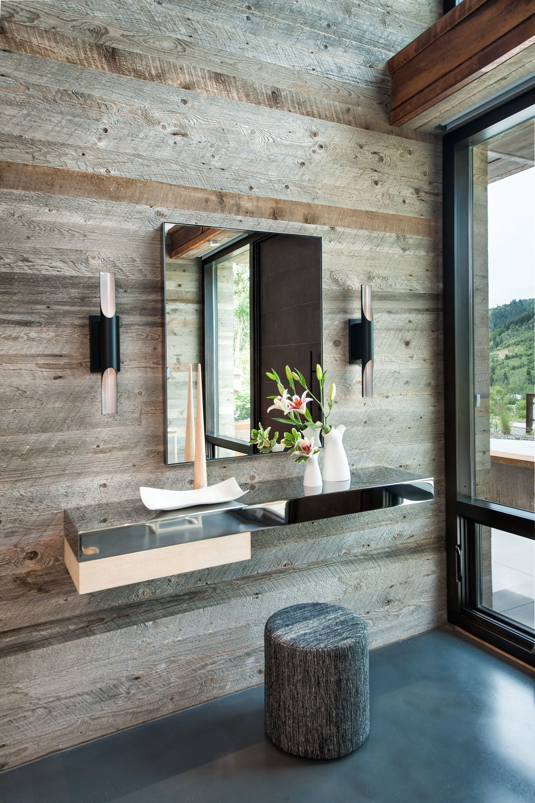 Rustic wood + hard metals  Lighting: Halfpipe Sconce by Boyd Lighting  60+ Modern Lighting Solutions by Dwell from Rustic Luxury
