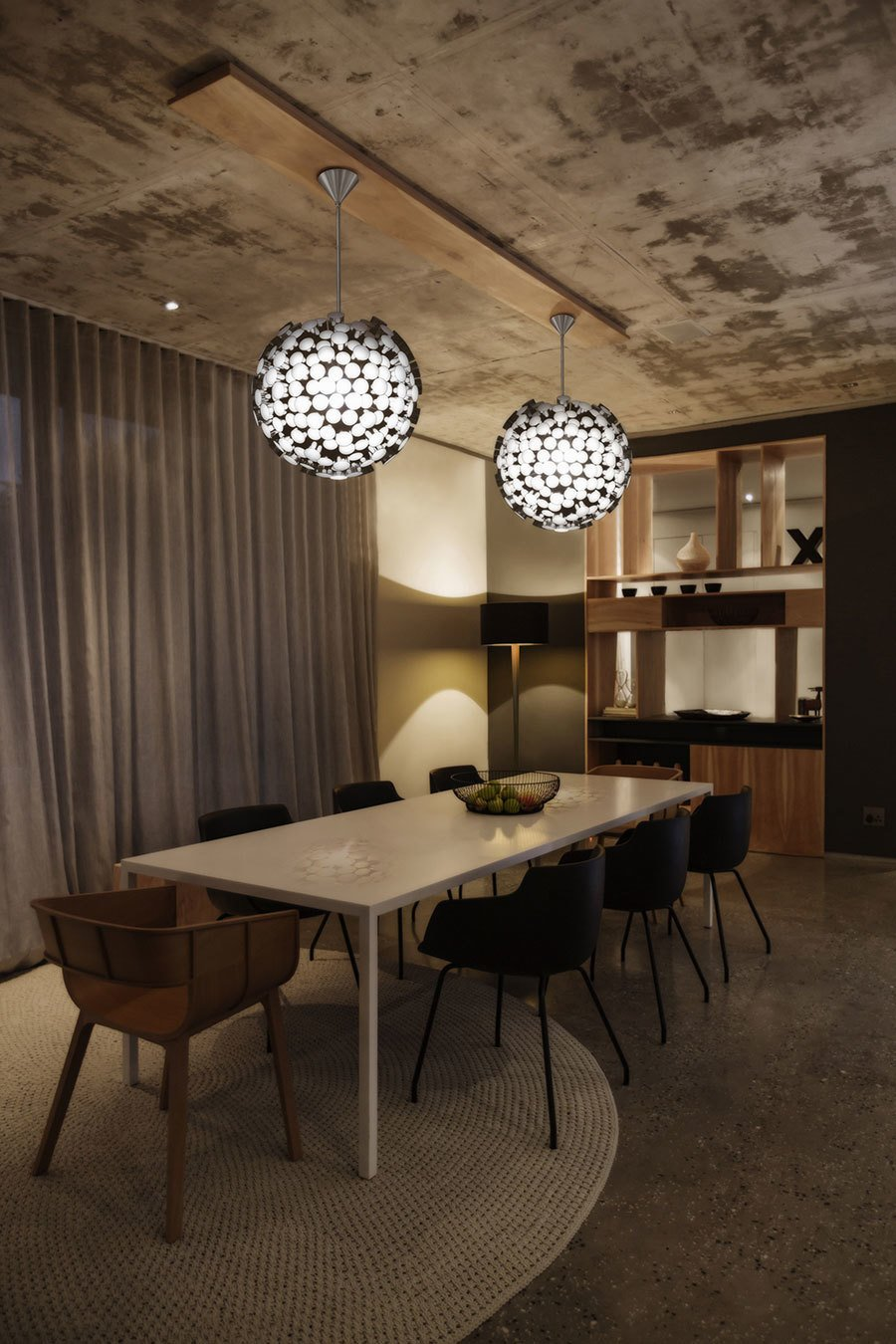 What once was a warehouse is now a luxury condo. This dining room features a pair of Asteroid Pendants. Delicious Dining Room Lighting by Boyd Lighting