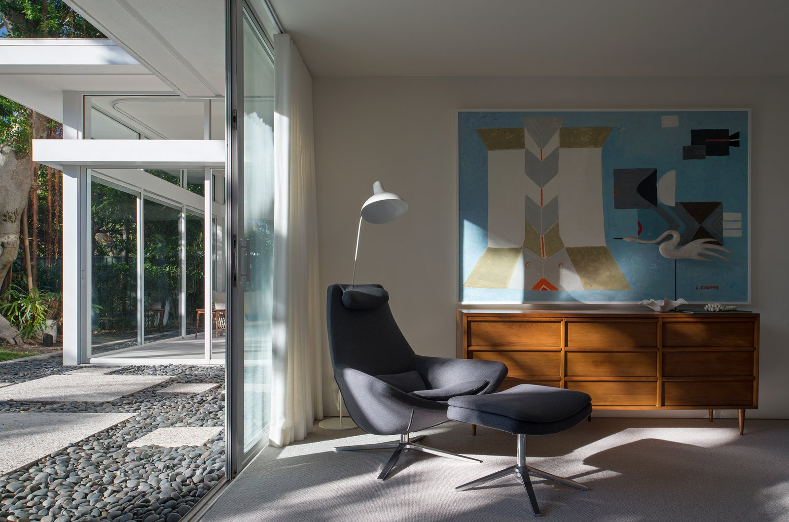 The architectural details of the home present dramatic shadows and highlights that evolve and dissolve throughout the day.