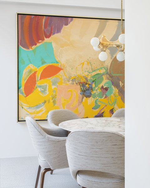 Throughout the day, the home is bright, airy and breezy, guided by both the architecture and the interior design. Ellen Hanson Designs appointed the home with furnishings that range between rich, colorful art and muted modern furniture. Photo 5 of The Pavilion House modern home
