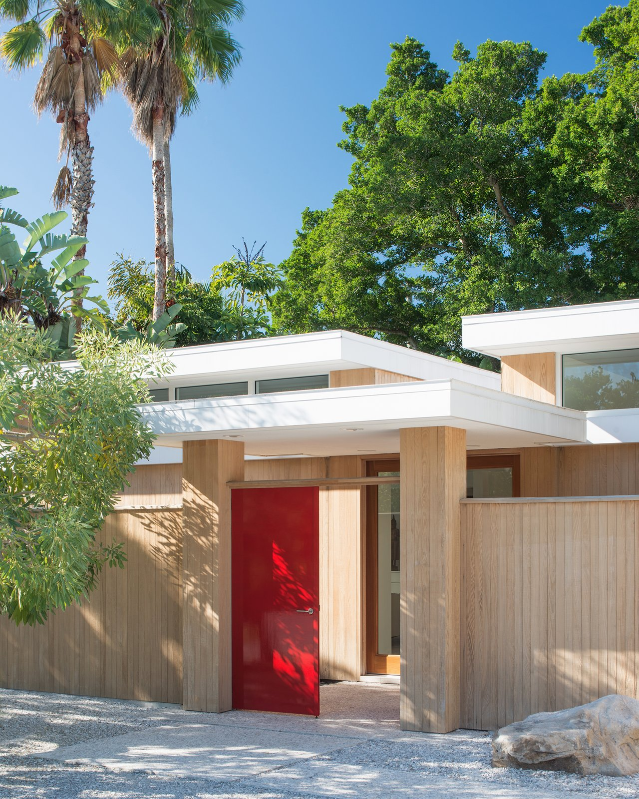 The main entrance of the Pavilion House welcomes guests into the interior courtyard, and then to a second set of doors that enter the main home.  The Pavilion House by Seamus Payne