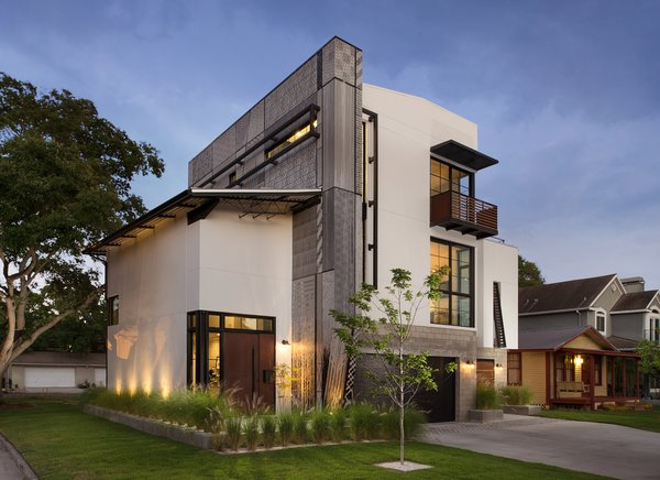 Modern home with outdoor, shrubs, front yard, grass, trees, hardscapes, walkways, and gardens. Each surface was treated as an opportunity for expression by the architect, Tobin Green. Photo 5 of 400SOLA