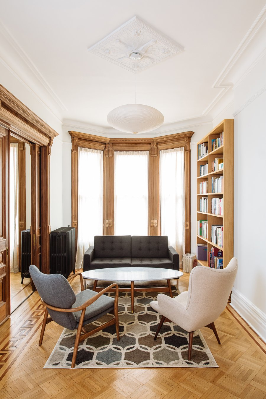 Study/Library  Tagged: Living Room, Recliner, Coffee Tables, Chair, Sofa, Pendant Lighting, Accent Lighting, Medium Hardwood Floor, and Light Hardwood Floor.  Brooklyn Brownstone by Sonya Lee Architect llc