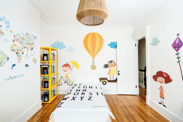 Children's bedroom: playful fabric decals enliven a historic room