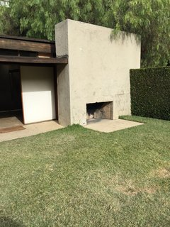 One of the multiple outdoor fireplaces used year-round for entertaining guests.