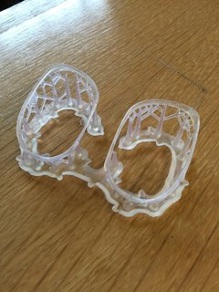 """The Future of Manufacturing Started in the 1980's - Photo 3 of 3 - 3D-printed frames for eye-glasses are thinner, more flexible and printed faster with the SLS method. You can also see the support """"trees"""" that will be broken off, leaving just the delicate frames."""