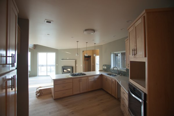 A modern kitchen that opens up into the living area Photo 4 of Round House in Wine Country modern home