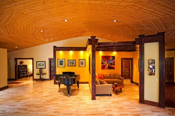 Modern home with living room, recessed lighting, ceiling lighting, and light hardwood floor. The seating area & ballroom Photo 3 of A Deltec Tree House