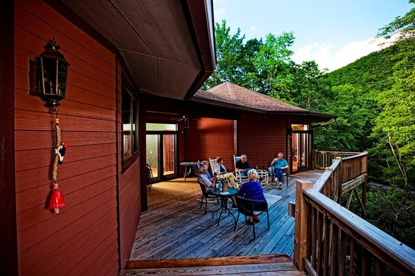 Modern home with outdoor, back yard, wood patio, porch, deck, trees, large patio, porch, deck, and decking patio, porch, deck. Wrap around deck allows him to even further embrace his mountainous surroundings Photo 4 of A Deltec Tree House