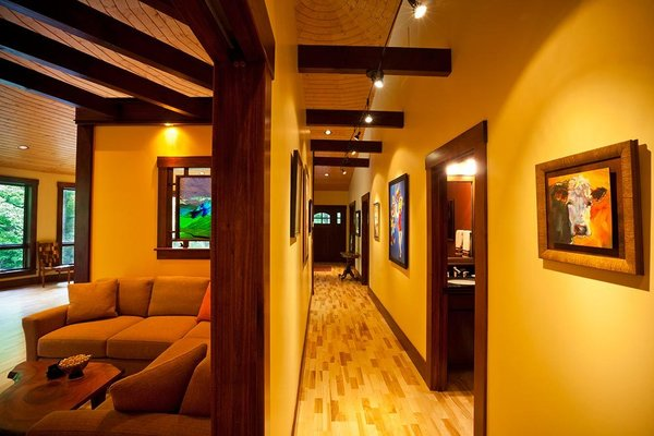 Modern home with hallway, light hardwood floor, and medium hardwood floor. Long, dramatic hallway Photo 7 of A Deltec Tree House