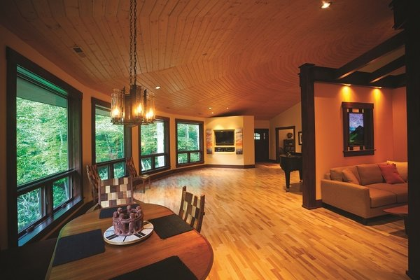 Modern home with light hardwood floor, ceiling lighting, windows, recessed lighting, and casement window type. View from the kitchen Photo 5 of A Deltec Tree House