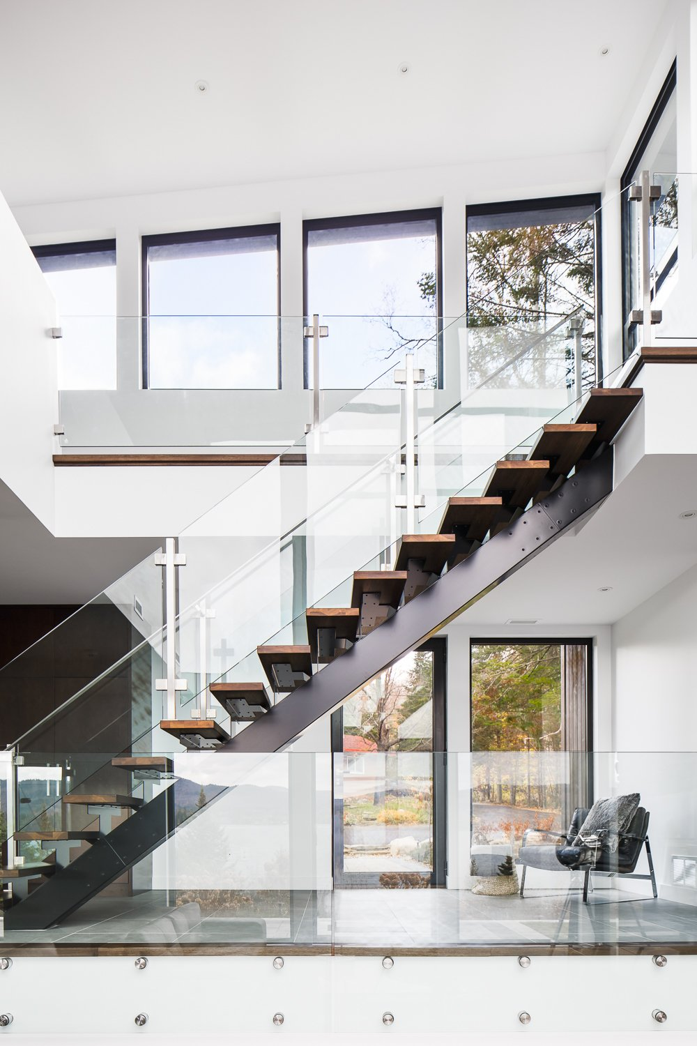 Tagged: Staircase, Wood Tread, and Glass Railing.  Prefab Homes by Dwell from Modern Lake Cabin